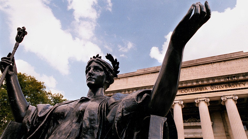 Bronze statue of Alma Mater, a woman sitting down in classical robes with a laurel wreath in her hair, and holding a scepter.