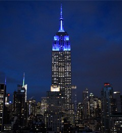 Photo of the Empire State Building glowing blue in honor of President Beilock's inauguration