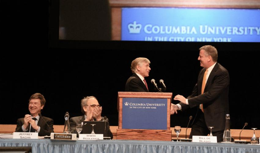 Photo of President Bollinger introducing Mayor Bill de Blasio at NYC Summit for Children.
