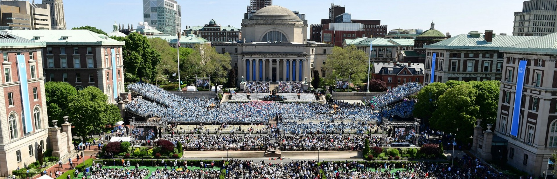 Photo of Low Library and the Columbia steps on the Morningside Campus, filled with people during Commencement