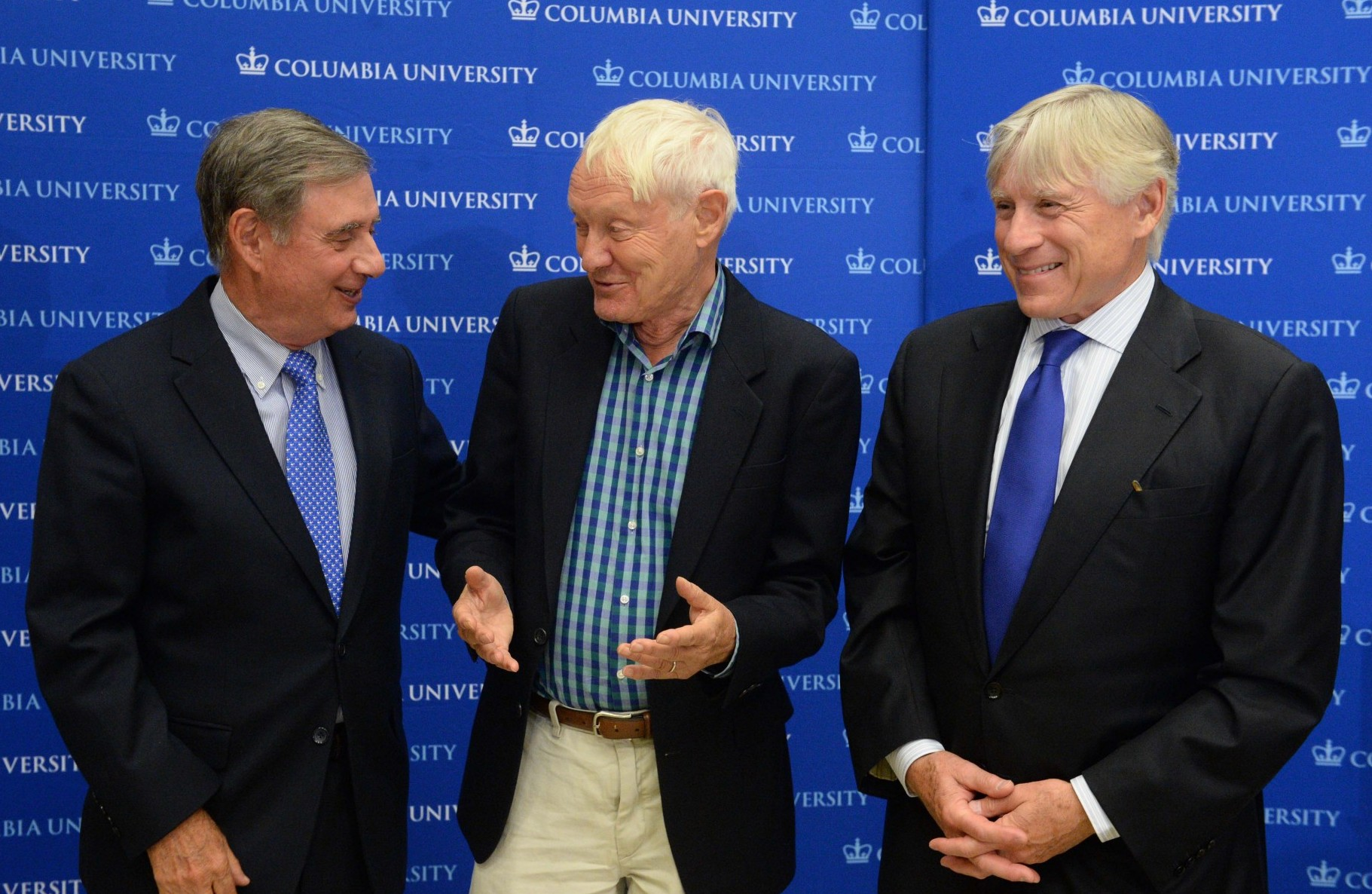 Lee Goldman, Joachim Frank and Lee Bollinger stand together after the celebration for the 2017 Nobel Prize in Chemistry is announced.