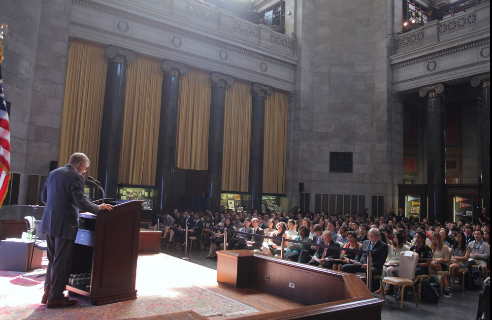 Photo of Lee Bollinger speaking in front of an audience in Low Rotunda