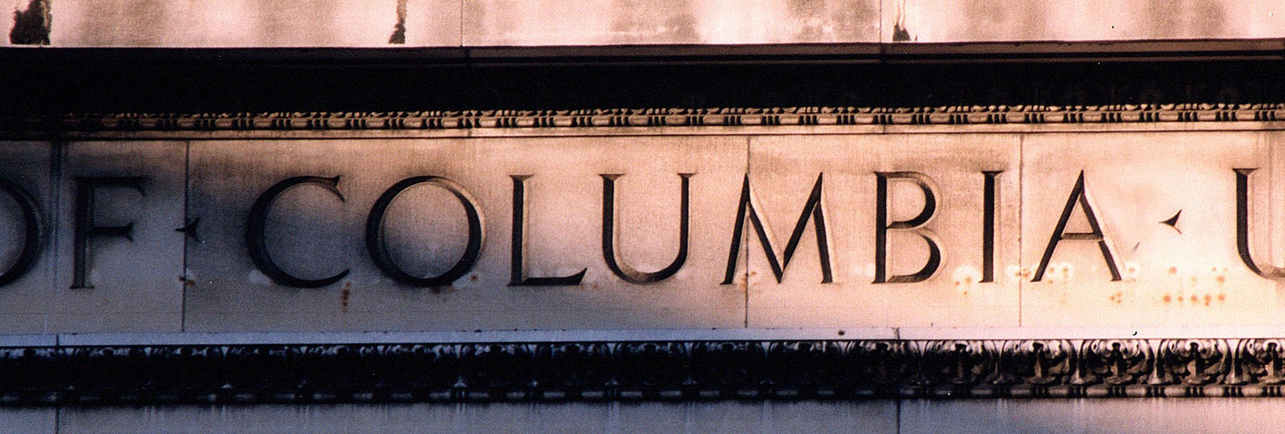 "Low Library facade, up close, displaying the word ""Columbia."""