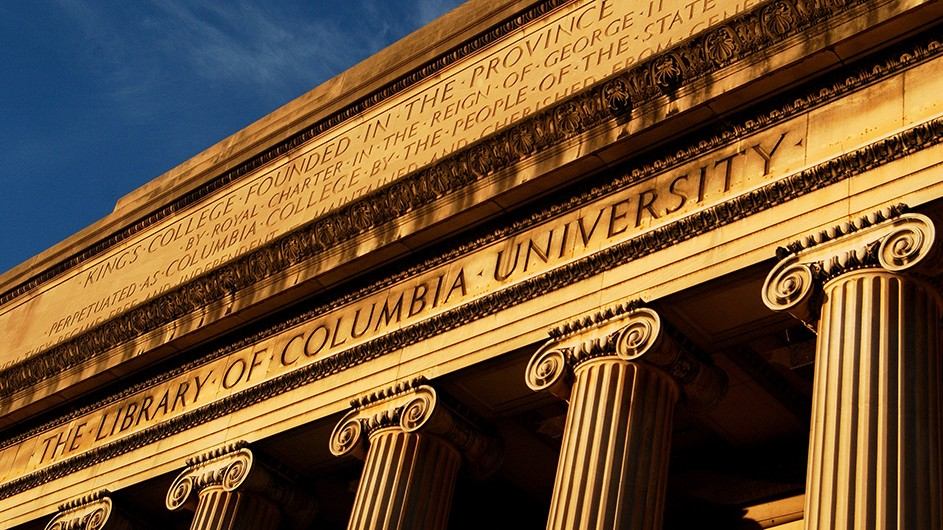 The columns and facade of the classically-designed Low Library on Columbia's Morningside campus, on a clear, blue day
