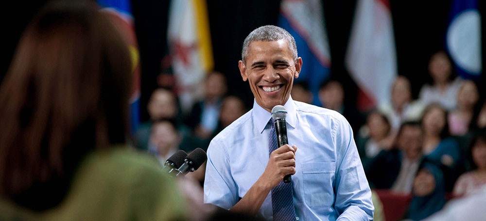 Photo of President Obama holding a microphone