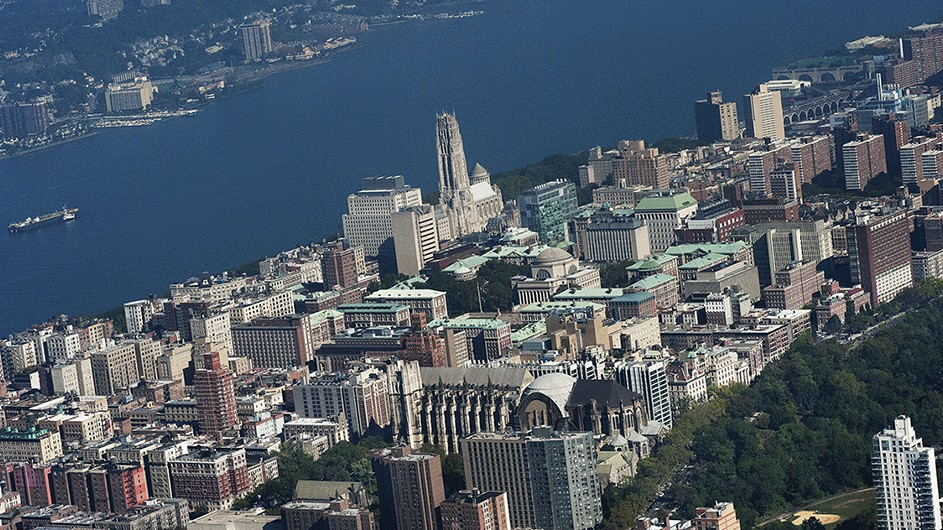 Aerial view of Columbia's Morningside campus, with a view of the Hudson River